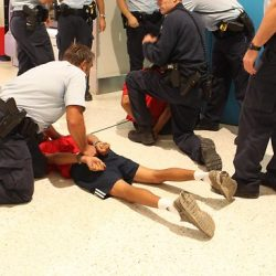 Arrest Youth on Ground Australia